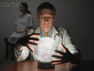 Massachusetts, USA --- Doctor Peering into Crystal Ball While Patient Waits --- Image by © Cary Wolinsky/Aurora Photos/Corbis