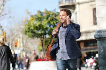26735582-young-urban-businessman-on-smart-phone-running-in-street-talking-on-smartphone-smiling-wearing-jacke